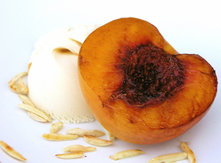 Grilled Peaches with Toasted Almonds and Vanilla Ice Cream