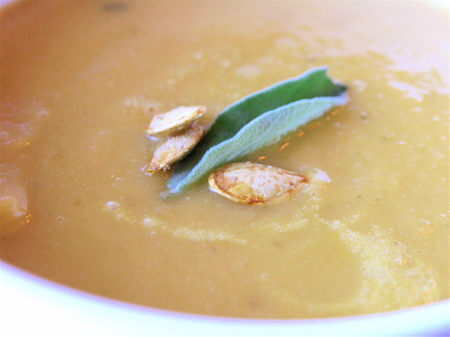 Sage and pumpkin seeds garnish the soup